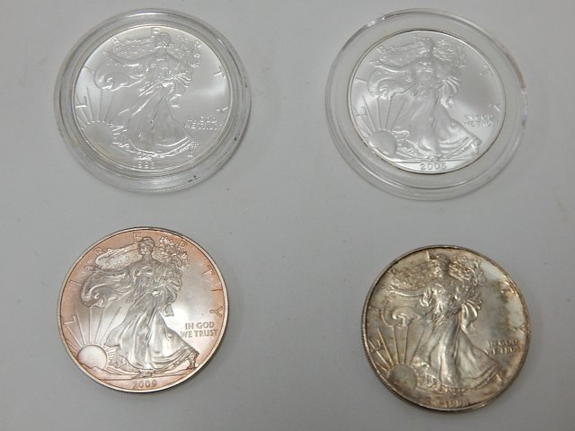 FOUR AMERICAN EAGLE SILVER DOLLARS