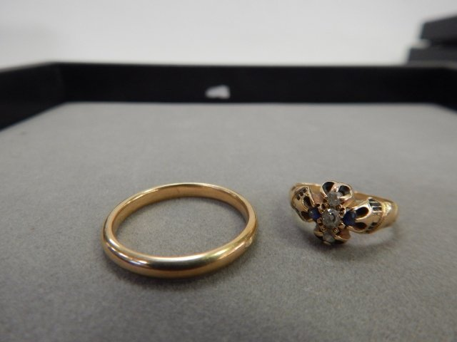 TWO 18 K GOLD RINGS
