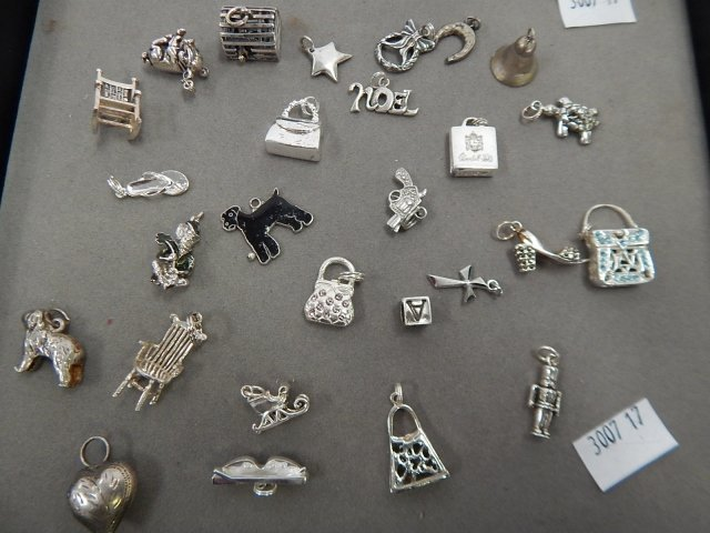 ASSORTED STERLING CHARMS