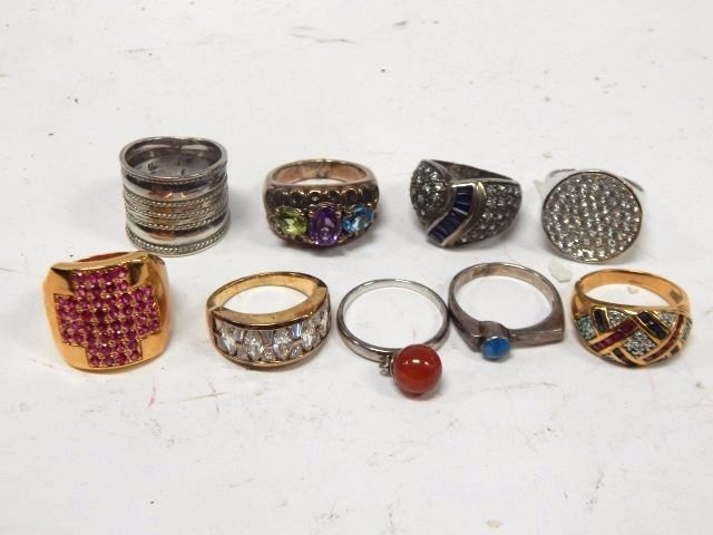 NINE STERLING SILVER RINGS