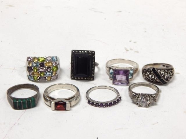 EIGHT STERLING SILVER RINGS