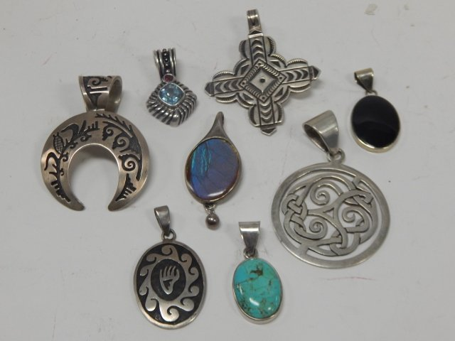 EIGHT STERLING SILVER PENDANTS