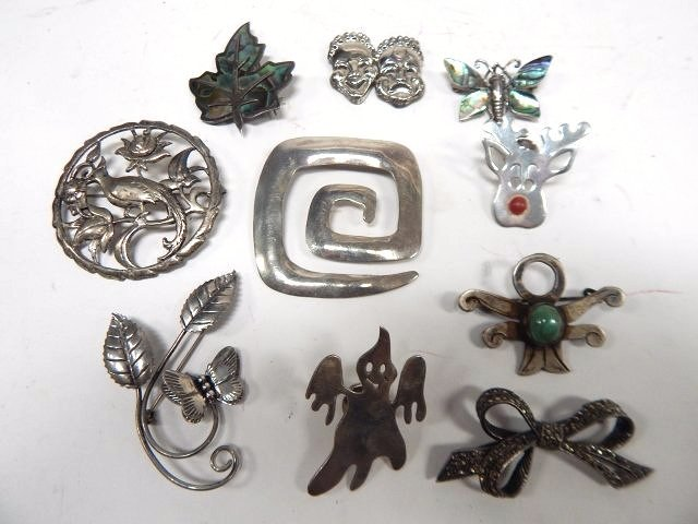 TEN STERLING SILVER PINS