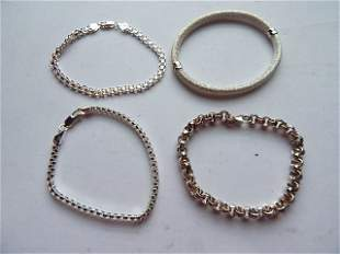 FOUR STERLING SILVER BRACELETS