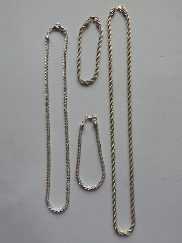TWO STERLING SILVER NECKLACES AND 2 BRACELETS