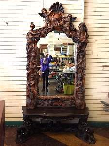 HEAVILY CARVED FIGURAL CONSOLE AND MIRROR