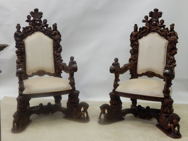 PAIR OF HEAVILY CARVED ARM CHAIRS