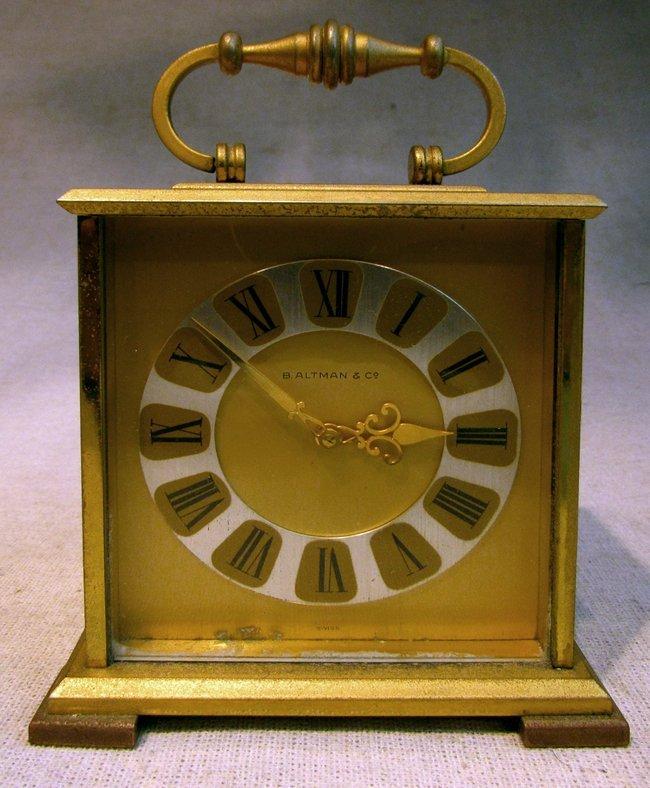 A Swiss Made Gilt Case Carrying Clock