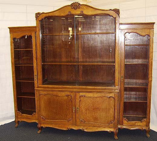 11: FRENCH CARVED OAK WALL UNIT WITH SLIDING GLASS