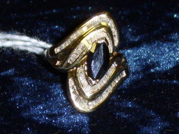 330: LADIES MARQUISE SAPPHIRE & BAGUETTE DIAMOND RING