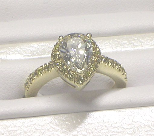 1037: Lady's 14k gold, diamond ring. Weights 3.1 dwt. P