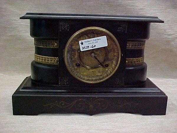 1203: CAST IRON VICTORIAN MANTEL CLOCK