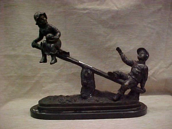 1212: FIGURAL BRONZE OF BOY & GIRL ON SEESAW
