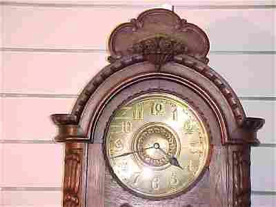 55: ANTIQUE OAK GERMAN GRANDFATHER CLOCK CIRCA 1900'S