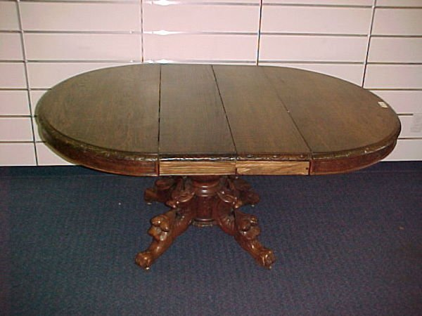 1313: CARVED FRENCH STYLE OAK OVAL DINING TABLE