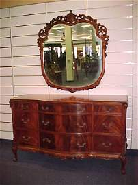 1879: MAHOGANY-CARVED DOUBLE DRESSER WITH MIRROR