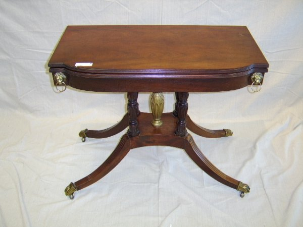 1108: BAKER-MAHOGANY FOLDING TOP CLAW FOOT GAME TABLE