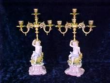 1290: PORCELAIN-GILT METAL PUTTI FIGURAL CANDELABRAS