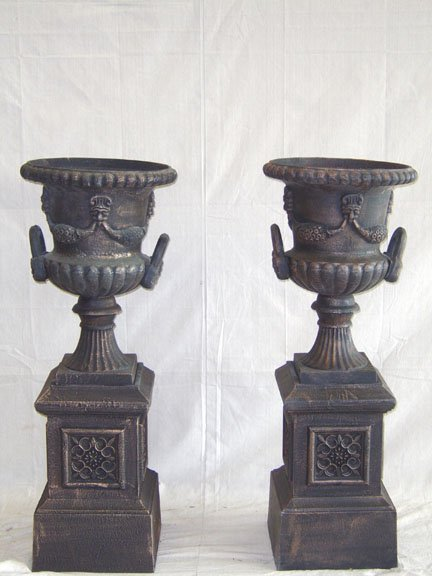1102: VICTORIAN STYLE CAST IRON HANDLED URNS