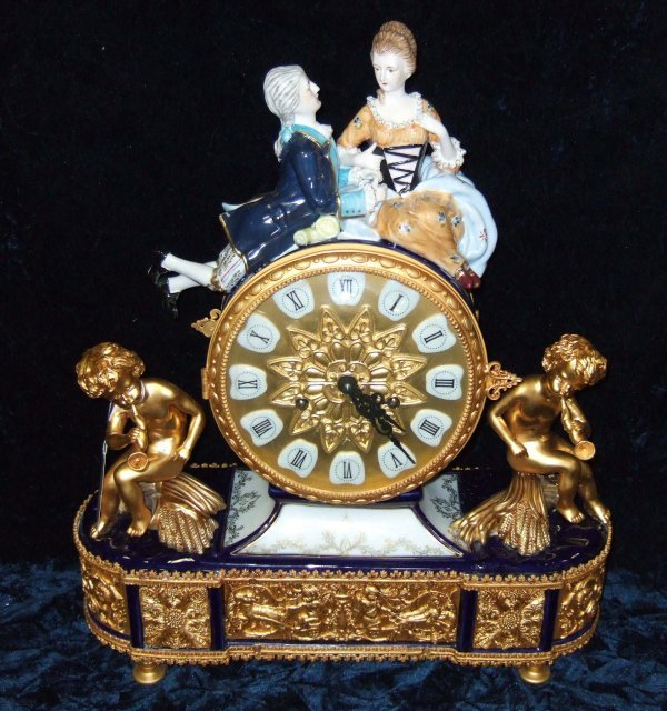 1106: FRENCH STYLE PORCELAIN & GILDED METAL CLOCK