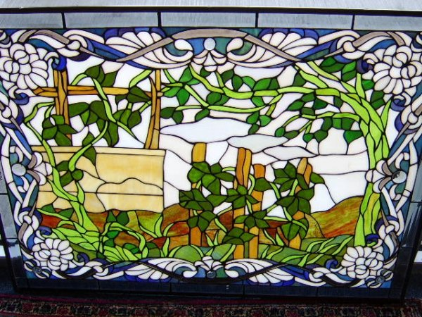 1123: TIFFANY STYLE STAINED GLASS WINDOW