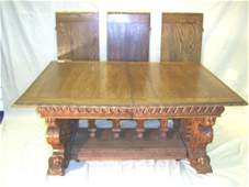 1251: FRENCH - FIGURAL CARVED OAK DINING TABLE