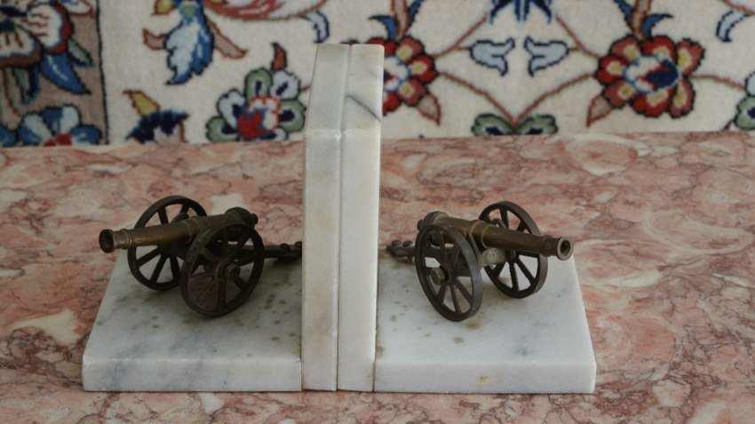Brass and marbell canon book ends