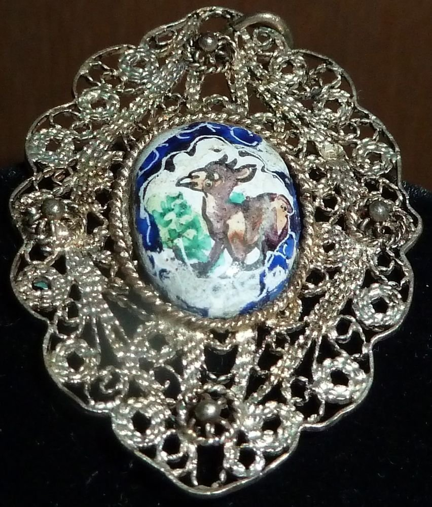 Cloisonne medallion with silver filigree