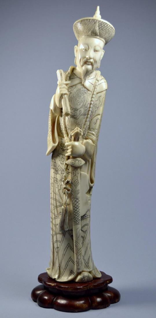 A LARGE CHINESE CARVED COW BONE STATUE OF A DEITY