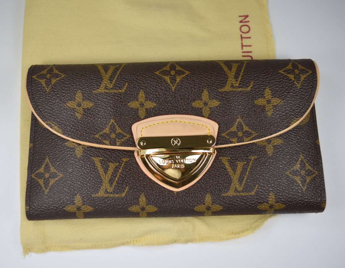 Wallet With Leather Accents Bearing Louis Vuitton Marks