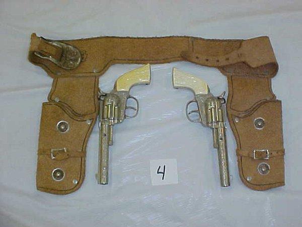 3004: Pair of Hubley rodeo die cast cap gun
