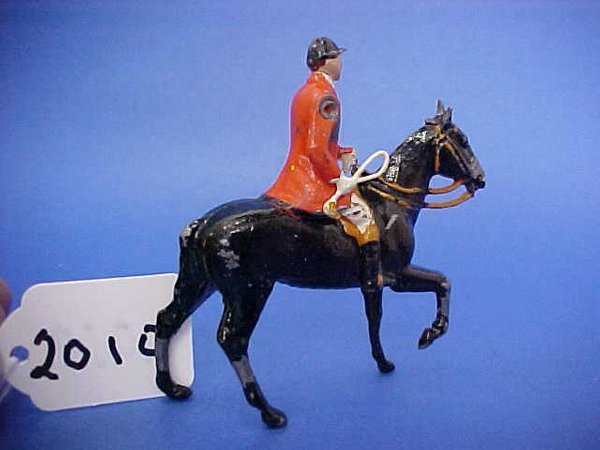 2010: Britains the meet, mounted male huntsman, horse r
