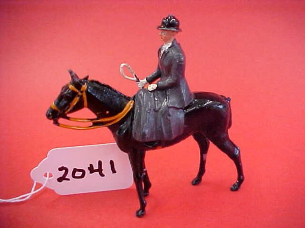 2041: Britains the meet, mounted female rider, side sad