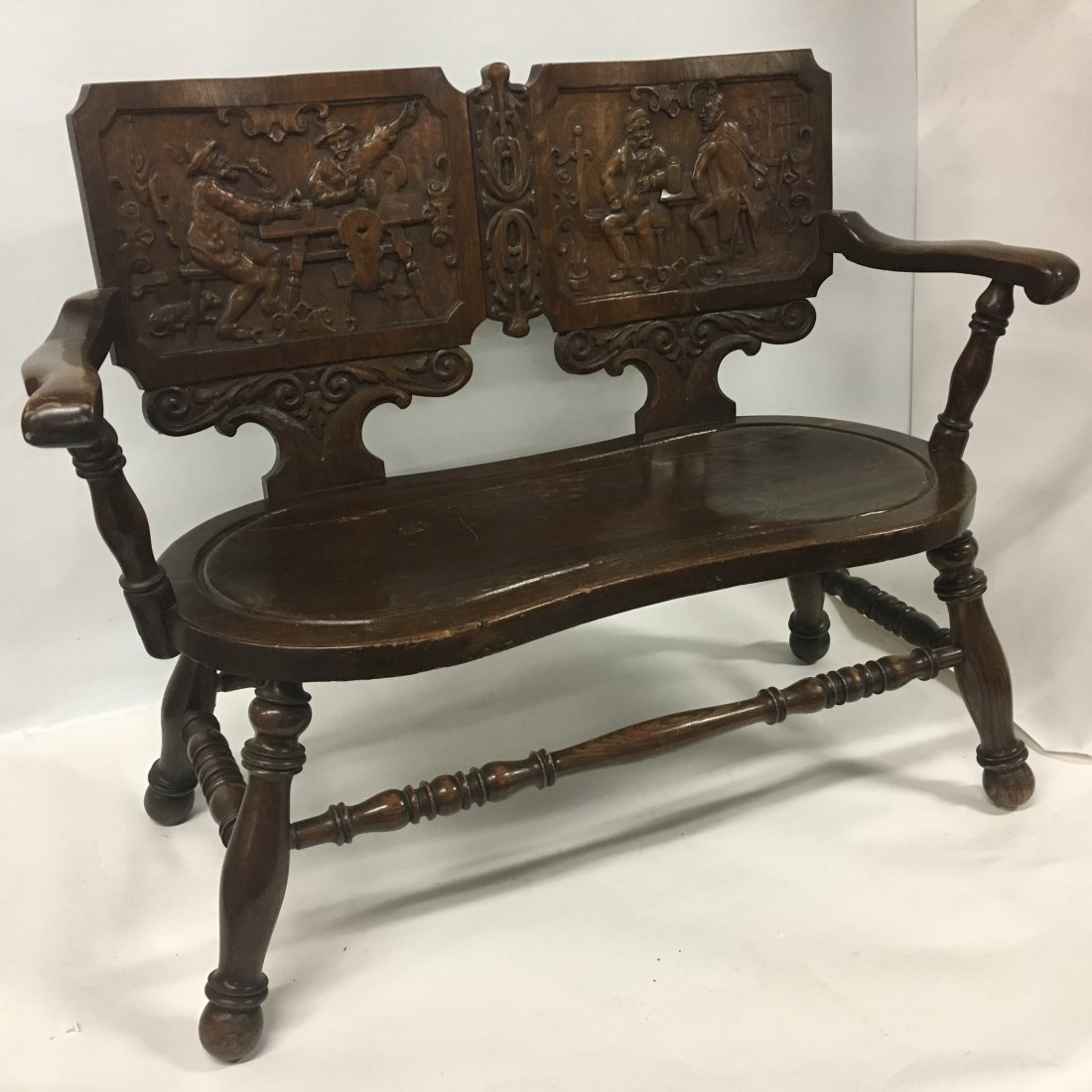 Figural carved Oak two person Decorative bench