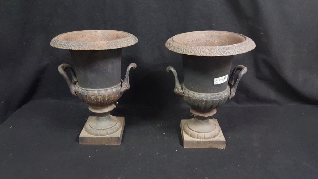 A Matching Pair of Cast Iron Urns