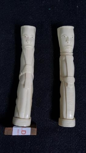 A Pair of carved bone African (?) figures.