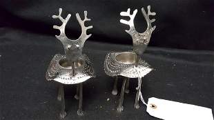 A Pair of Polished Metal Reindeer Candle Holders