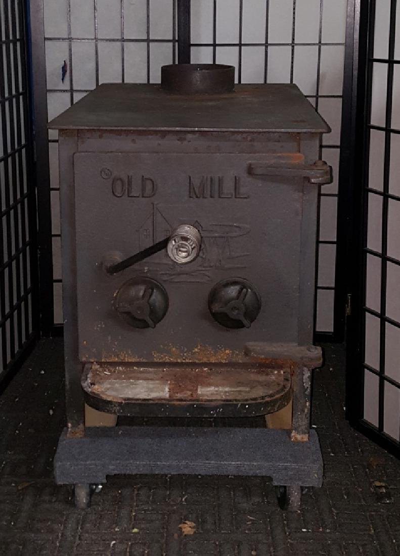 "Old Mill Cast Iron Wood Burning 24"" Log Stove"
