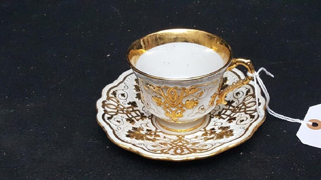 A Meissen Gold Encrusted Cup & Saucer