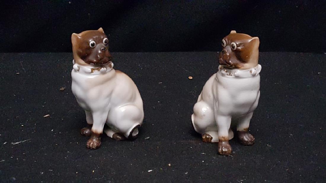 An Antique Pair of Porcelain Pug Dogs