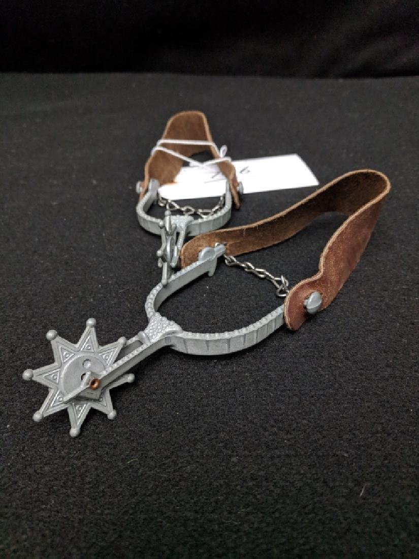 A Pair Of Vintage Toy Western Spurs