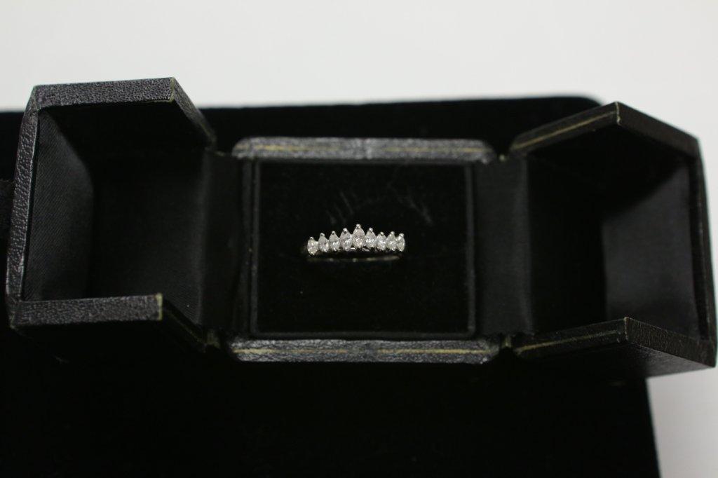A 14K white gold ladies cocktail ring w/ diamonds