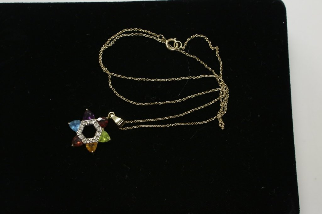 A 14K gold Star of David set with stones
