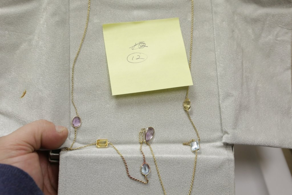 14K Yellow gold chain with multiple stones