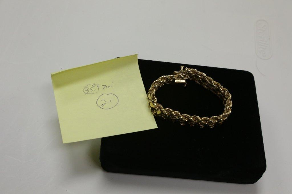 A Heavy 14K Gold Charm Bracelet