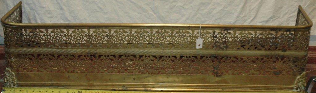 Large ornate brass fire fender