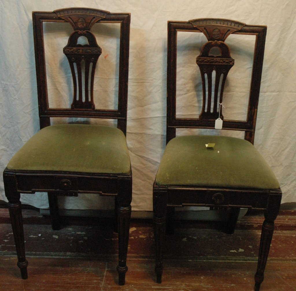 A pair of 1920's carved Jacobean chairs