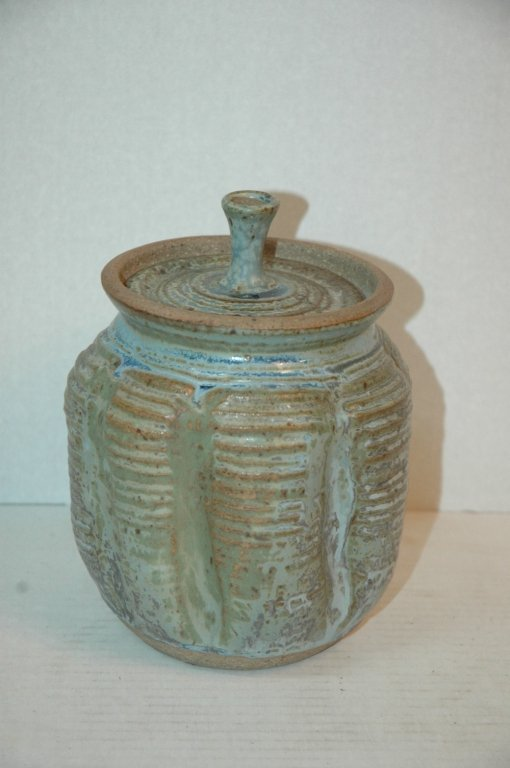A Karen Karnes Covered Pottery Jar, Green Glaze