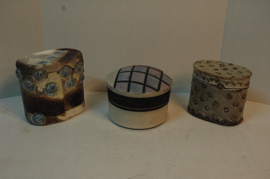 Glazed pottery jars with unique tops