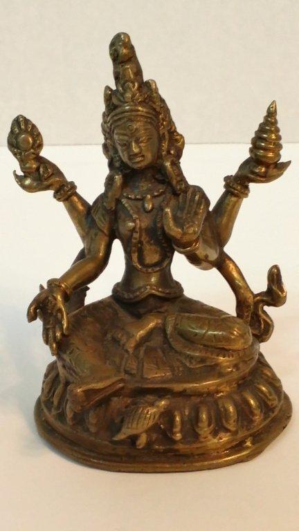 An antique bronze Asian many armed goddess